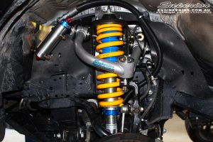 Front right inside guard view of the fitted Superior Front Strut with Coil Spring & Superior Chromoly Upper Control Arm