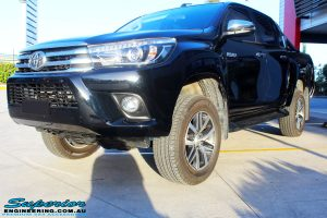 """Left front side view of a Toyota Revo Hilux Dual Cab in Black after fitment of a Superior Remote Reservoir 3"""" Inch Lift Kit"""