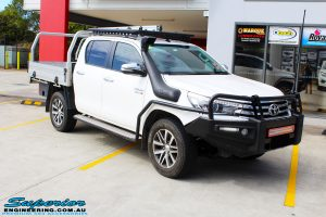 """Right front side view of a White Toyota Revo Hilux before fitting a Superior Remote Reservoir 2"""" Inch Lift Kit"""