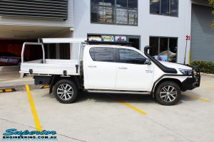 """Right side view of a White Toyota Revo Hilux before fitting a Superior Remote Reservoir 2"""" Inch Lift Kit"""