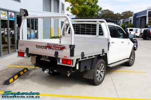 "Rear right view of a White Toyota Revo Hilux before fitting a Superior Remote Reservoir 2"" Inch Lift Kit"