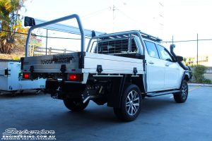 """Rear left view of a White Toyota Revo Hilux after fitting a Superior Remote Reservoir 2"""" Inch Lift Kit"""
