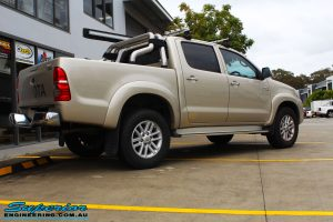 """Rear right view of a Gold Toyota Vigo Hilux Dual Cab before fitment of a 2"""" Inch Lift Kit & MCC4x4 Bullbar"""