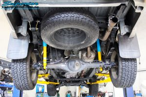 Rear mid underbody view of the fitted Bilstein Rear Shocks, EFS Leaf Springs with EFS U-Bolt Kit & Shackles