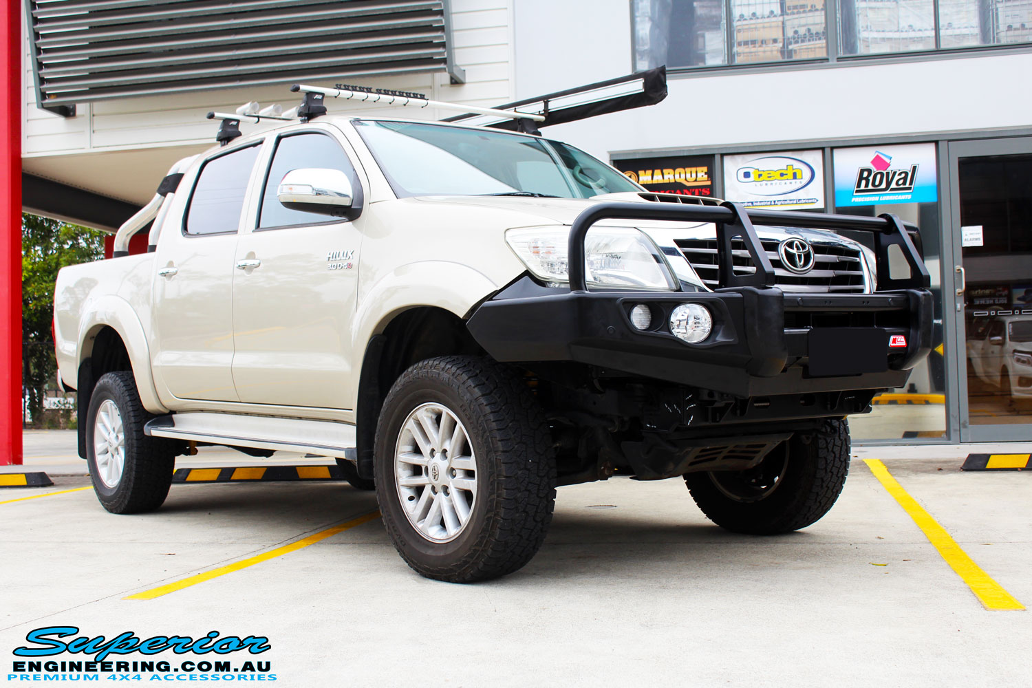 "Right front side view of a Gold Toyota Vigo Hilux Dual Cab after fitment of a 2"" Inch Lift Kit & MCC4x4 Bullbar"