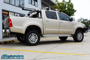 """Right side view of a Gold Toyota Vigo Hilux Dual Cab after fitment of a 2"""" Inch Lift Kit & MCC4x4 Bullbar"""