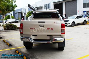 """Rear view of a Gold Toyota Vigo Hilux Dual Cab after fitment of a 2"""" Inch Lift Kit & MCC4x4 Bullbar"""