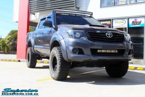 Right front side view of a Grey Toyota Vigo Hilux before fitment of a range of Superior and various other brands suspension components