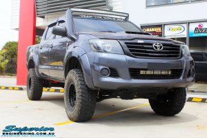 Front right side view of a Grey Toyota Vigo Hilux after fitment of a range of Superior and various other brands suspension components