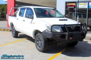 """Right front side view of a White Toyota Vigo Hilux before fitting a Superior Remote Reservoir 3"""" Inch Lift Kit"""