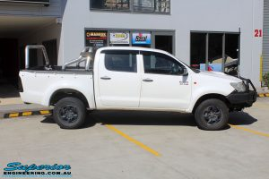 """Right side view of a White Toyota Vigo Hilux before fitting a Superior Remote Reservoir 3"""" Inch Lift Kit"""