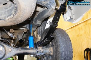 Rear right underbody shot of the Superior Adjustable Remote Reservoir Shock with Leaf Spring & Greaseable Shackle