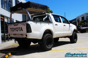 """Rear right view of a White Toyota Vigo Hilux after fitting a Superior Remote Reservoir 3"""" Inch Lift Kit"""