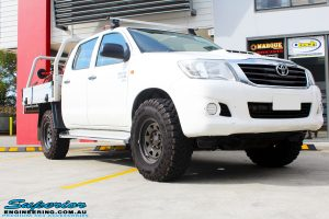 Right front side view of a White Toyota Vigo Hilux before fitment of a MCC 4x4 Bullbar