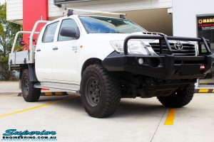 Right front side view of a White Toyota Vigo Hilux after fitment of a MCC 4x4 Bullbar