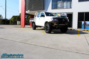 """Right front side view of a Toyota Vigo Hilux Dual Cab in White before fitment of a Superior Nitro Gas 2"""" Inch Lift Kit, Rhino 4x4 Evolution 3D Winch Bar, VRS Winch, Legendex 409 Stainless Steel 3"""" Exhaust, Legendex Thrust Monkey Throttle Control, Legendex Rock Sliders, Legendex Optimizer Remap Service, Stainless Snorkel & Nitto Trail Grappler Tyres"""