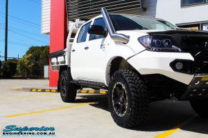"""Front right close up shot of a Toyota Vigo Hilux Dual Cab in White after fitment of a Superior Nitro Gas 2"""" Inch Lift Kit, Rhino 4x4 Evolution 3D Winch Bar, VRS Winch, Legendex 409 Stainless Steel 3"""" Exhaust, Legendex Thrust Monkey Throttle Control, Legendex Rock Sliders, Legendex Optimizer Remap Service, Stainless Snorkel & Nitto Trail Grappler Tyres"""