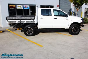 """Right side view of a Toyota Vigo Hilux Dual Cab in White before fitment of a Superior Nitro Gas 2"""" Inch Lift Kit, Rhino 4x4 Evolution 3D Winch Bar, VRS Winch, Legendex 409 Stainless Steel 3"""" Exhaust, Legendex Thrust Monkey Throttle Control, Legendex Rock Sliders, Legendex Optimizer Remap Service, Stainless Snorkel & Nitto Trail Grappler Tyres"""