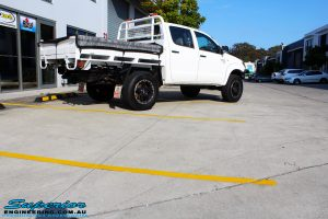 """Rear right view of a Toyota Vigo Hilux Dual Cab in White before fitment of a Superior Nitro Gas 2"""" Inch Lift Kit, Rhino 4x4 Evolution 3D Winch Bar, VRS Winch, Legendex 409 Stainless Steel 3"""" Exhaust, Legendex Thrust Monkey Throttle Control, Legendex Rock Sliders, Legendex Optimizer Remap Service, Stainless Snorkel & Nitto Trail Grappler Tyres"""