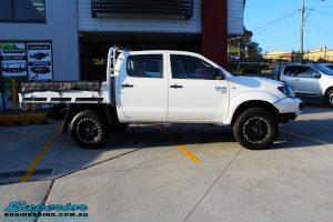 "Right side view of a Toyota Vigo Hilux Dual Cab in White after fitment of a Superior Nitro Gas 2"" Inch Lift Kit, Rhino 4x4 Evolution 3D Winch Bar, VRS Winch, Legendex 409 Stainless Steel 3"" Exhaust, Legendex Thrust Monkey Throttle Control, Legendex Rock Sliders, Legendex Optimizer Remap Service, Stainless Snorkel & Nitto Trail Grappler Tyres"