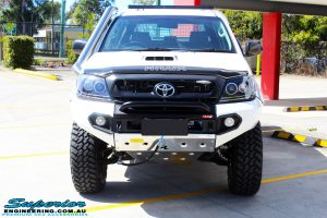 """Front on bonnet shot of a Toyota Vigo Hilux Dual Cab in White after fitment of a Superior Nitro Gas 2"""" Inch Lift Kit, Rhino 4x4 Evolution 3D Winch Bar, VRS Winch, Legendex 409 Stainless Steel 3"""" Exhaust, Legendex Thrust Monkey Throttle Control, Legendex Rock Sliders, Legendex Optimizer Remap Service, Stainless Snorkel & Nitto Trail Grappler Tyres"""