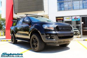 """Right front side view of a Ford PXII Ranger in Black before fitment of a Superior Nitro Gas 2"""" Inch Lift Kit with King Springs & EFS Springs"""