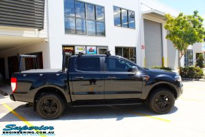 """Right side view of a Ford PXII Ranger in Black before fitment of a Superior Nitro Gas 2"""" Inch Lift Kit with King Springs & EFS Springs"""