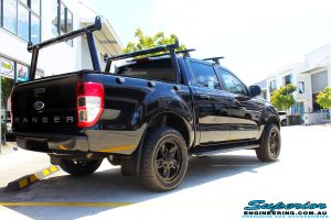 """Rear right view of a Ford PXII Ranger in Black before fitment of a Superior Nitro Gas 2"""" Inch Lift Kit with King Springs & EFS Springs"""