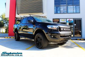 """Right front side view of a Ford PXII Ranger in Black after fitment of a Superior Nitro Gas 2"""" Inch Lift Kit with King Springs & EFS Springs"""
