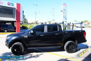"""Left side view of a Ford PXII Ranger in Black after fitment of a Superior Nitro Gas 2"""" Inch Lift Kit with King Springs & EFS Springs"""