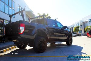 """Rear right view of a Ford PXII Ranger in Black after fitment of a Superior Nitro Gas 2"""" Inch Lift Kit with King Springs & EFS Springs"""