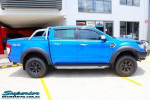 "Right side view of a Blue Ford PXII Ranger before fitment of a Superior Nitro Gas 2"" Inch Lift Kit with King Springs & EFS Springs"