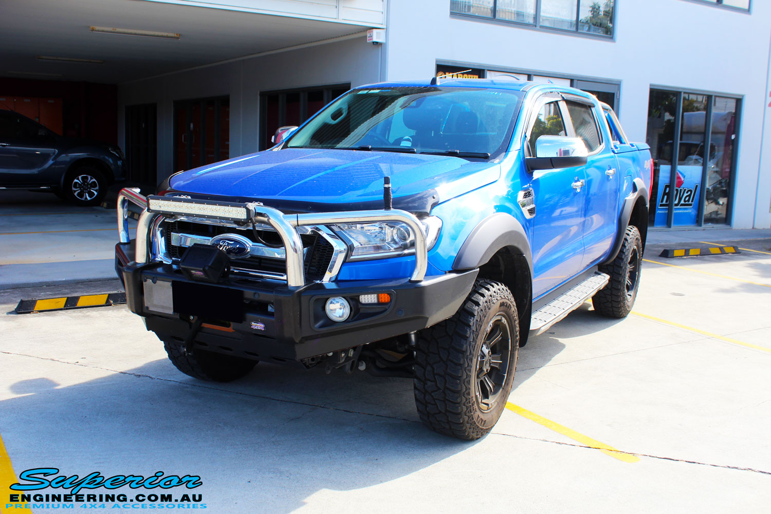 """Left front side view of a Blue Ford PXII Ranger after fitment of a Superior Nitro Gas 2"""" Inch Lift Kit with King Springs & EFS Springs"""