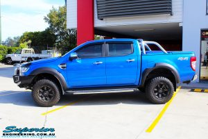 """Left side view of a Blue Ford PXII Ranger after fitment of a Superior Nitro Gas 2"""" Inch Lift Kit with King Springs & EFS Springs"""