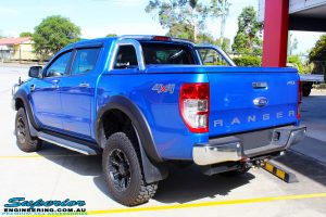 """Rear left view of a Blue Ford PXII Ranger after fitment of a Superior Nitro Gas 2"""" Inch Lift Kit with King Springs & EFS Springs"""