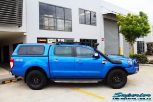 """Right side view of a Blue Ford PXII Ranger before fitment of a Superior Nitro Gas 2"""" Inch Lift Kit with King Springs & EFS Springs"""