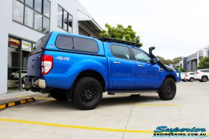 """Rear right view of a Blue Ford PXII Ranger before fitment of a Superior Nitro Gas 2"""" Inch Lift Kit with King Springs & EFS Springs"""