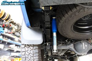 Rear left underbody shot of the fitted Nitro Gas Shock + Leaf Spring with U-Bolt Kit