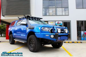 """Right front side view of a Blue Ford PXII Ranger after fitment of a Superior Nitro Gas 2"""" Inch Lift Kit with King Springs & EFS Springs"""