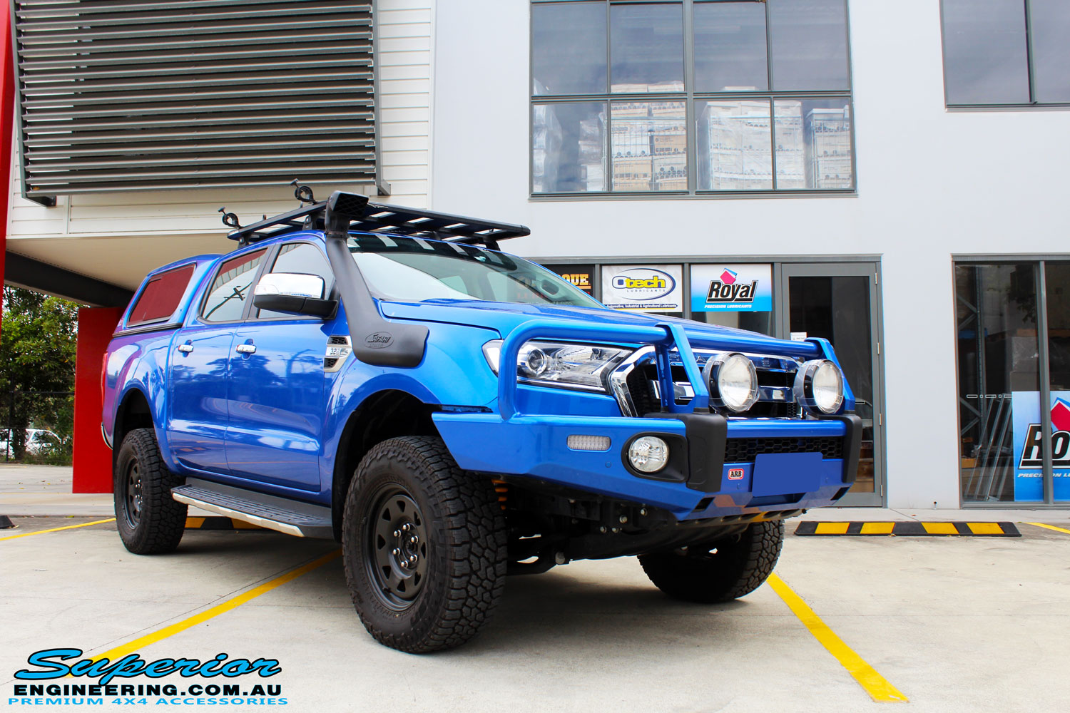 "Right front side view of a Blue Ford PXII Ranger after fitment of a Superior Nitro Gas 2"" Inch Lift Kit with King Springs & EFS Springs"