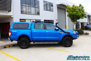 """Right side view of a Blue Ford PXII Ranger after fitment of a Superior Nitro Gas 2"""" Inch Lift Kit with King Springs & EFS Springs"""