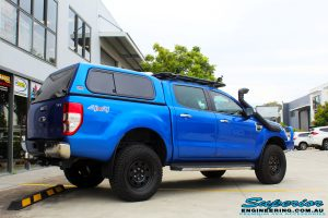 """Rear right view of a Blue Ford PXII Ranger after fitment of a Superior Nitro Gas 2"""" Inch Lift Kit with King Springs & EFS Springs"""