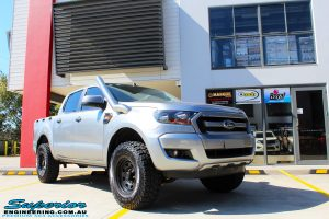 """Right front side view of a Silver Ford PXII Ranger before fitment of a Bilstein 2"""" Inch Lift Kit with King Springs & EFS Leaf Springs"""