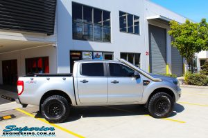 """Right side view of a Silver Ford PXII Ranger before fitment of a Bilstein 2"""" Inch Lift Kit with King Springs & EFS Leaf Springs"""