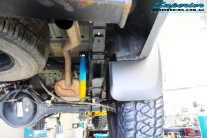 Rear right underbody view of the fitted Bilstein Shocks + EFS Leaf Springs