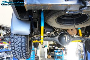 Rear left underbody view of the fitted Bilstein Shocks + EFS Leaf Springs