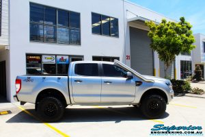 """Right side view of a Silver Ford PXII Ranger after fitment of a Bilstein 2"""" Inch Lift Kit with King Springs & EFS Leaf Springs"""