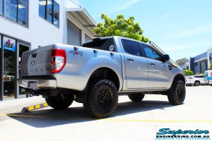 """Rear right view of a Silver Ford PXII Ranger after fitment of a Bilstein 2"""" Inch Lift Kit with King Springs & EFS Leaf Springs"""