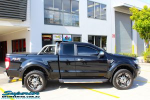 """Right side view of a Ford PXII Ranger in Black before fitment of a Superior 2"""" Inch Remote Reservoir Lift Kit + Airbag Man Leaf Air Kit"""