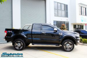 """Right side view of a Ford PXII Ranger in Black after fitment of a Superior 2"""" Inch Remote Reservoir Lift Kit + Airbag Man Leaf Air Kit"""